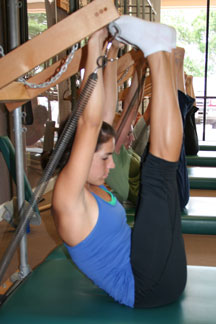 pilates tower stretches